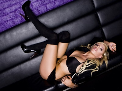 Sexy girl in the club wearing black lingerie and long socks